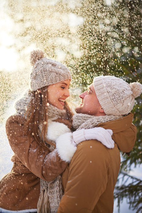 A couple embracing in the snow