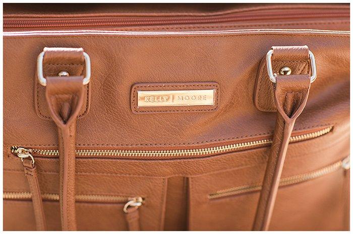 The logo of Kelly Moore Libby 2 Camera Bag.