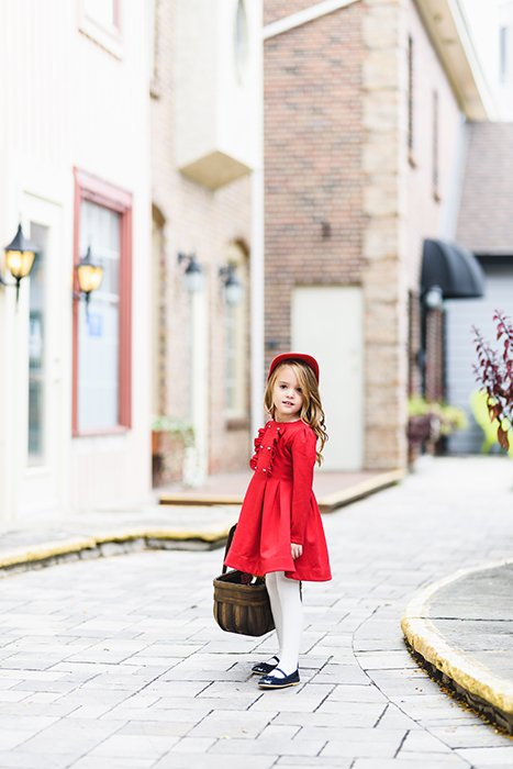 Photograph of a girl in a red dress taken with the Sigma 85mm f/1.4 Art lens