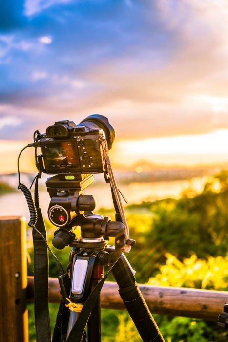 A DSLR camera on a tripod