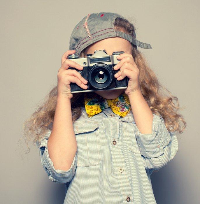A kid taking a photo