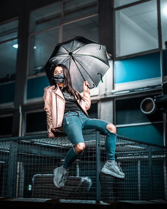 Image of a young female model with umbrellas shot with the RF 50mm f/1.2L USM lens