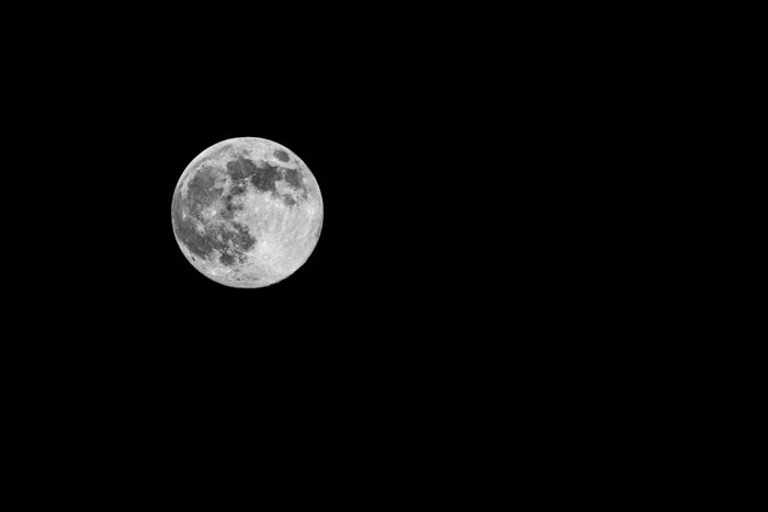 Full moon with craters agaianst a black sky