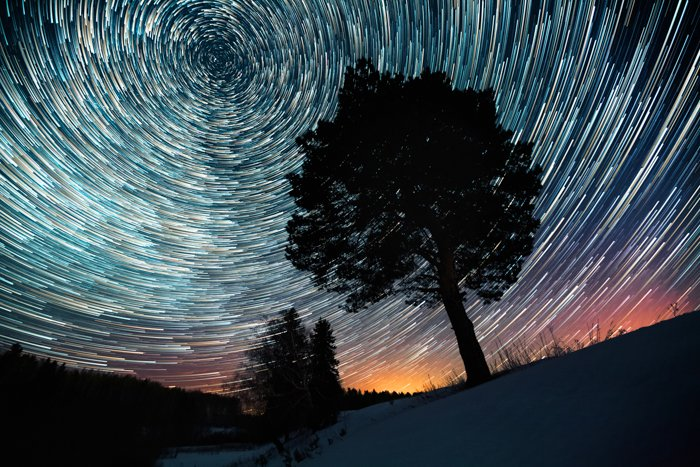 A long exposure astrophotography image of star trails