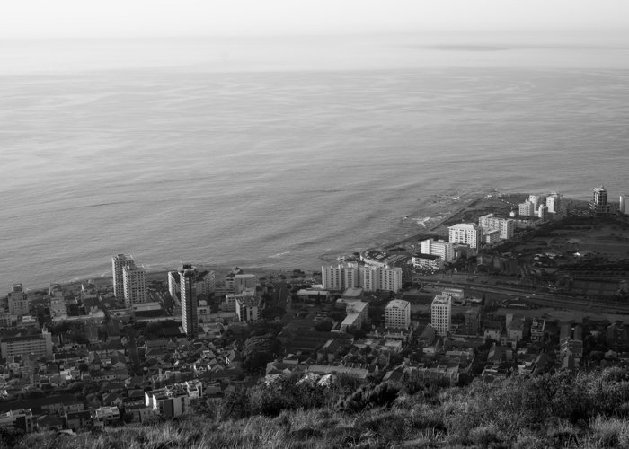 A black and white aerial photography of a seaside city
