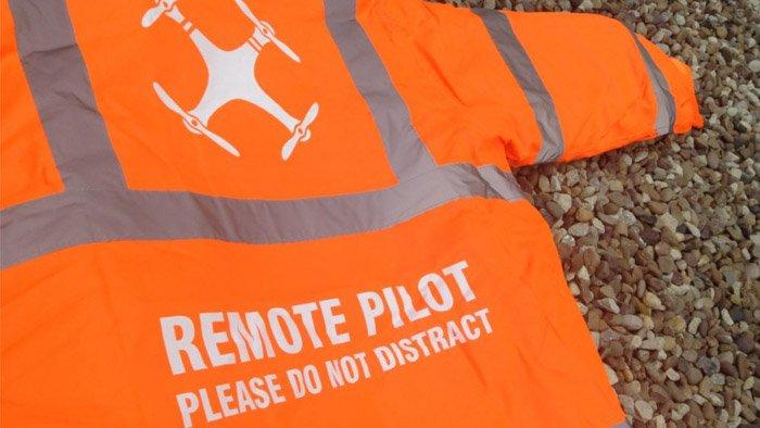 An image of a neon drone pilot vest