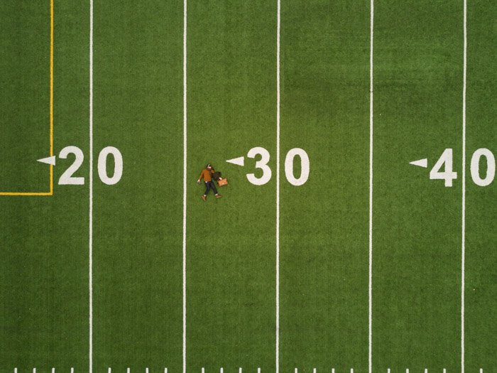 A flat lay image of a football field photographed with a drone