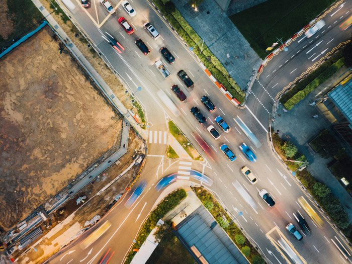 a drone photography image of cars at a busy city intersection