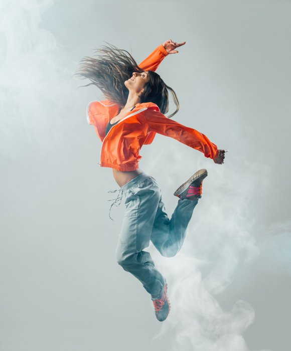 A woman leaping in the air shot with a faster shutter speed