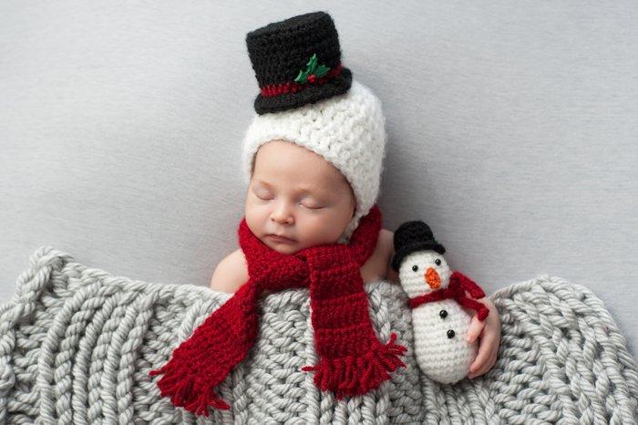 Newborn baby dressed as a little snowman