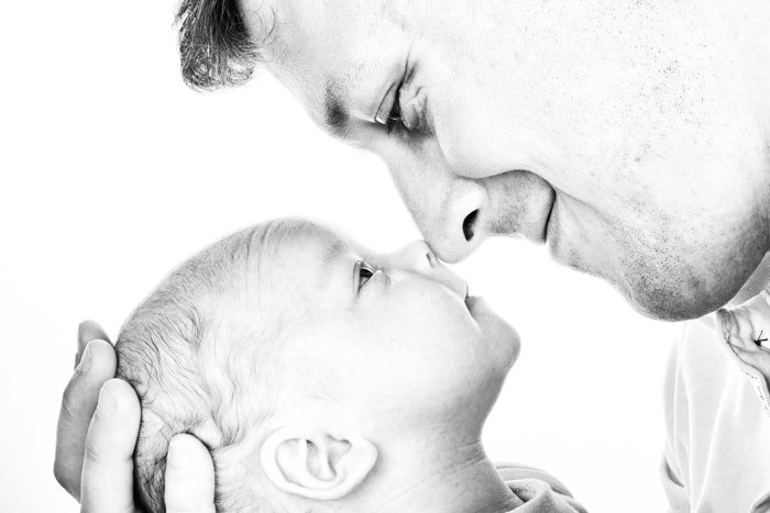 Sweet newborn photo idea of the baby and father touching noses