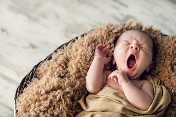 Sweet portrait of a newborn baby yawning