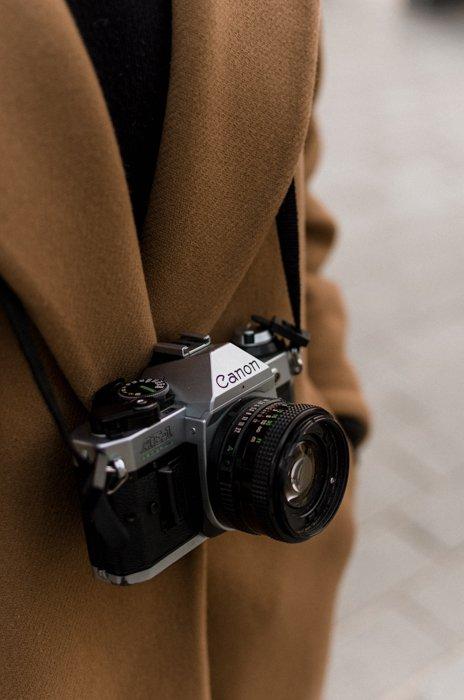 Vintage Canon SLR film hanging on a shoulder strap