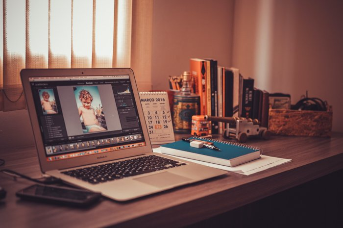 Image of a laptop with an editing software on a desktop