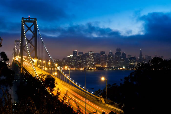 An image of Bay Bridge and San Francisco city view at night