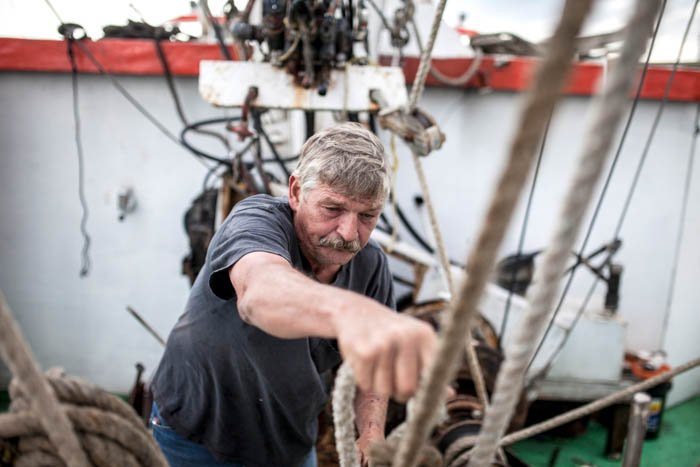 portrait of a sailor readying a boat