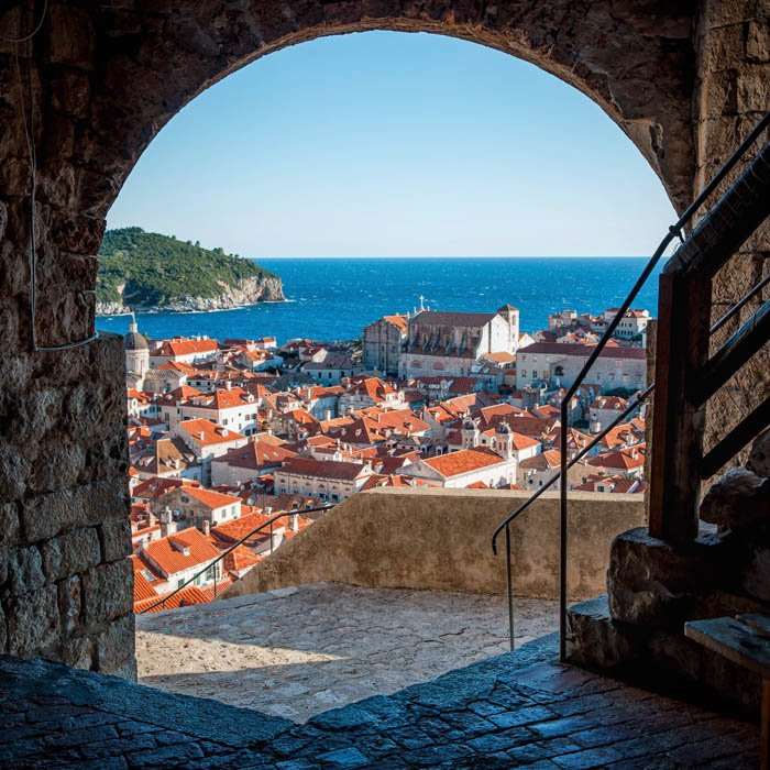 A travel photography image of a Mediterranean village by the seaside