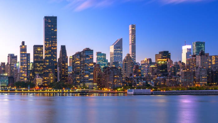 Cityscape image of New York City skyline of Midtown Manhattan from across the Hudson River.