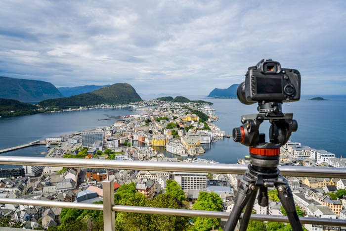 Cityscape travel photography with a camera on a tripod in the city of Alesund, Norway.