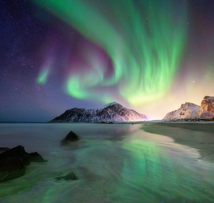 A travel photography image of a beautiful landscape at night with Northern lights