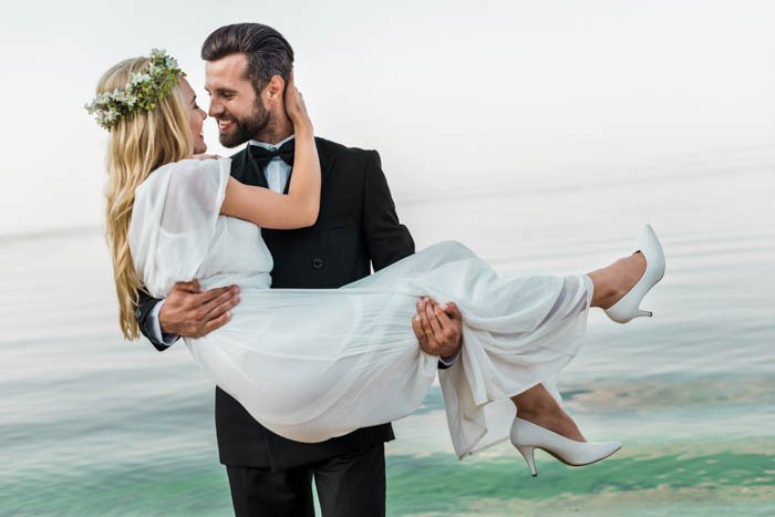 Picture of a groom holding the bride