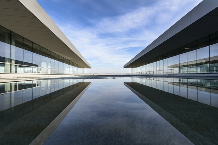 Architecture photography of two modern buildings in symmetry.
