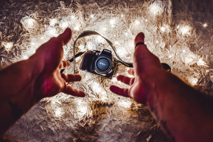 Hand throwing a Nikon DSLR camera