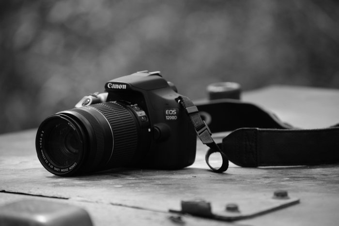 Canon EOS 1200D camera on a table