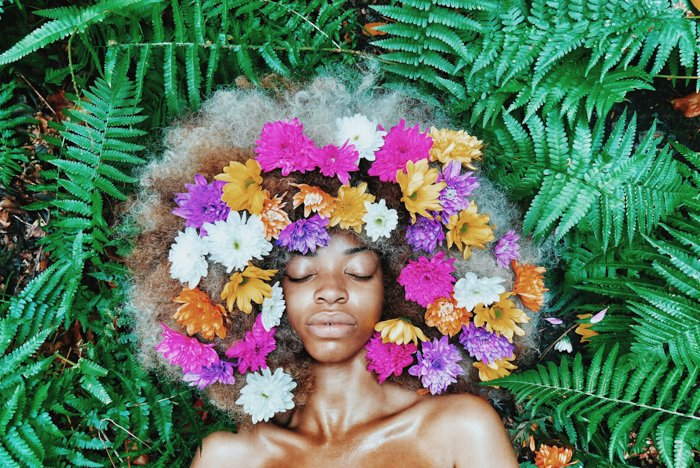 A conceptual portrait photography of a beautiful young black women