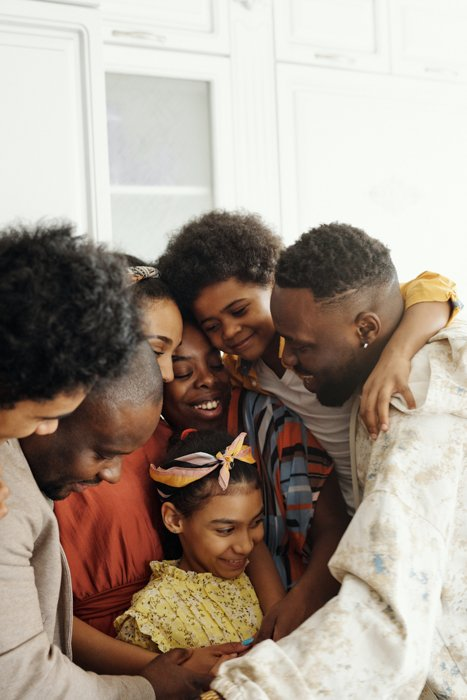 family picture of a group of of seven hugging each other