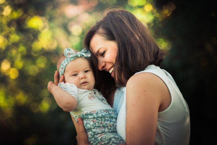 family photo poses mother with baby