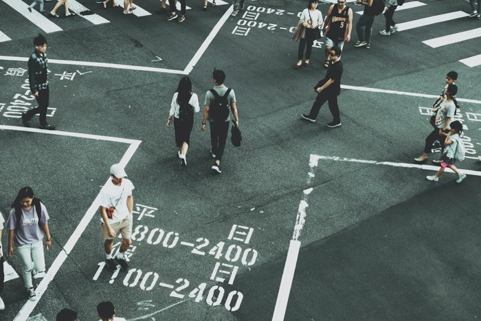 image of people at a street crossing