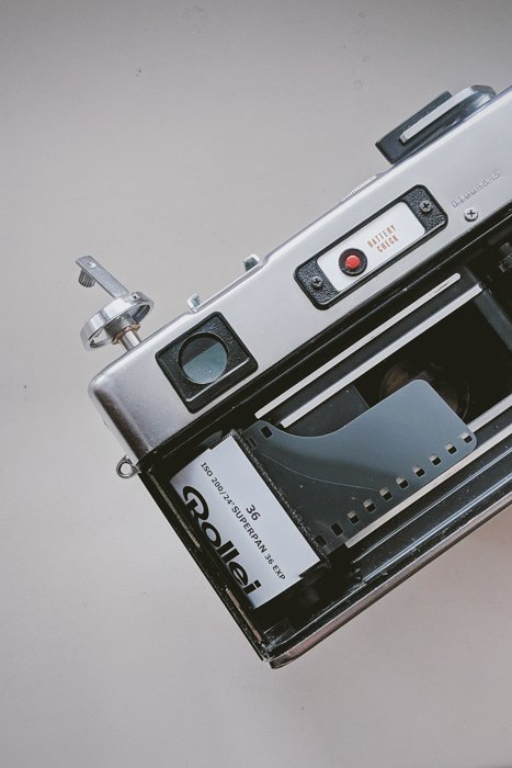 An image of a roll of 35mm film loaded in an analog camera
