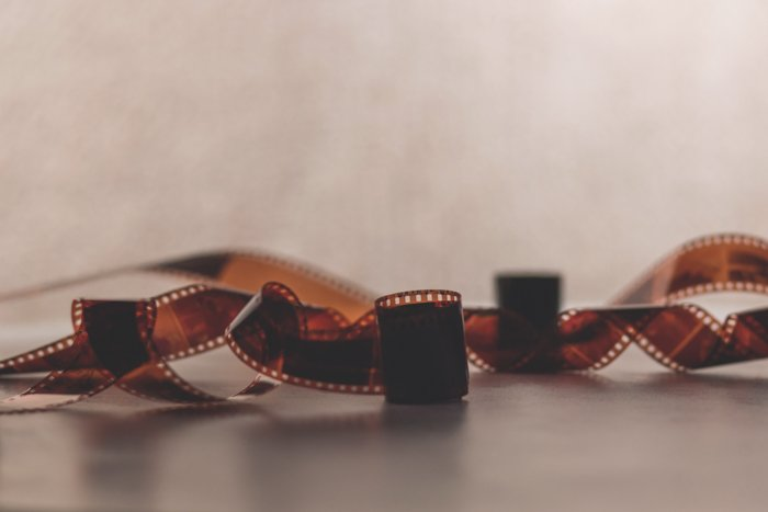 An image of a twisted roll of 35mm film negatives on a flat surface