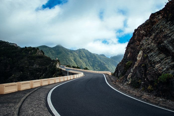 Image of a road cutting through the mountains to show how to use leading lines in photography