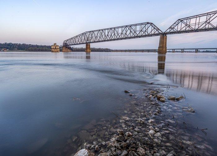 long exposure river and bridge