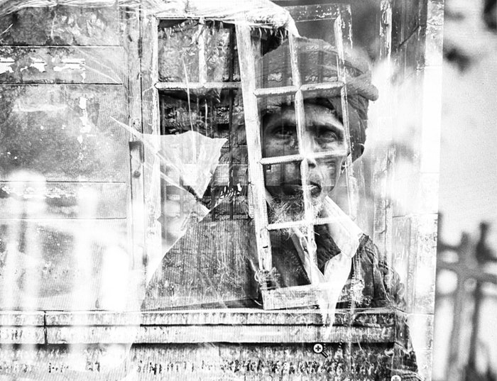 Double exposure person behind window