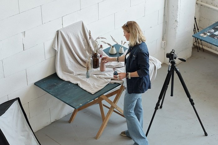 high angle photo of a woman creating a composition for photography