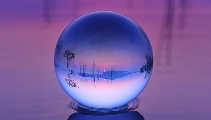 crystal ball set in water during blue hour