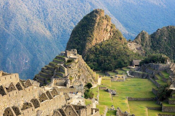 a photo of machu pichu peru in the andes mountains