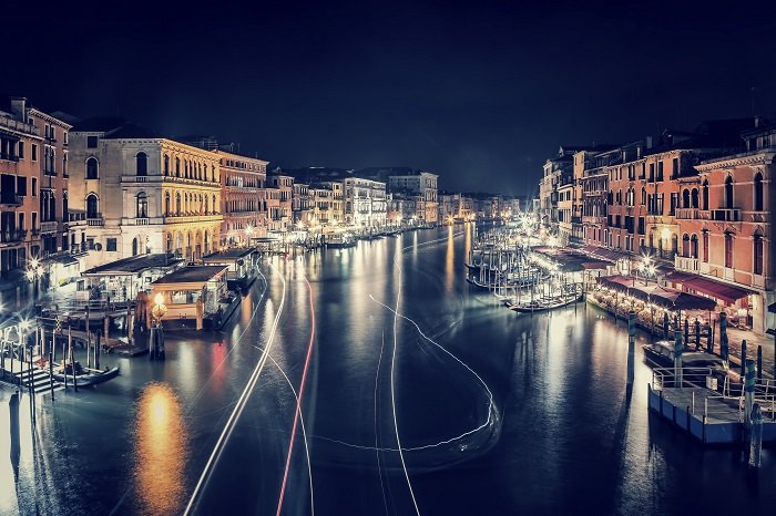 a timelapse photo of the grand canal in venice city at night