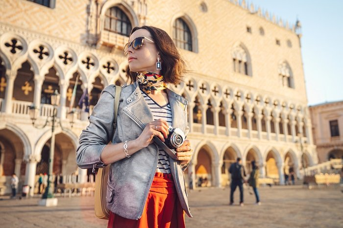 female photographer at a square in Venice