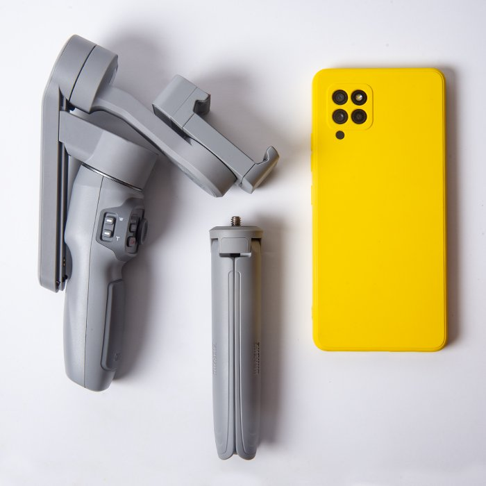 a flat lay of a Zhiyun Smooth Q3 with a yellow smartphone