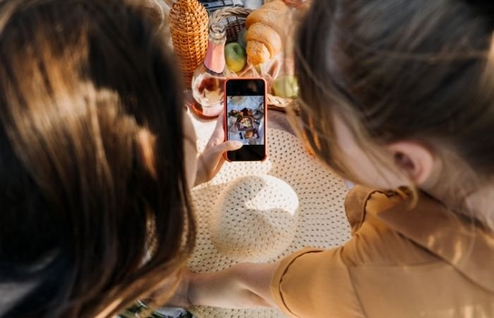 two women looking at a a food photography flat lay image