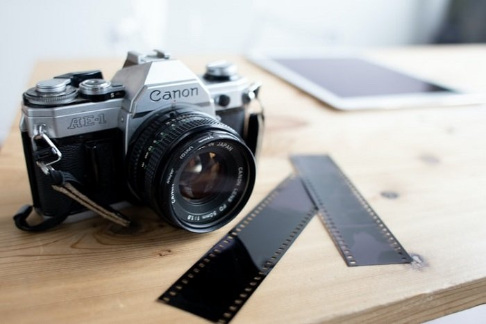 Canon AE-1 camera on a wooden table