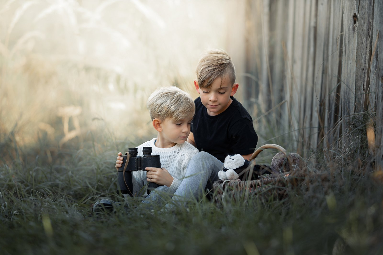 Photo of two children playing outdoors