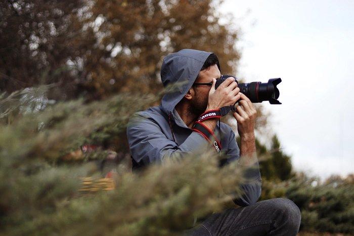 Man using Canon camera