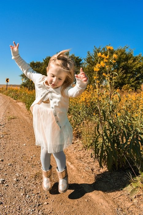 image of a child dancing on a picturesque path