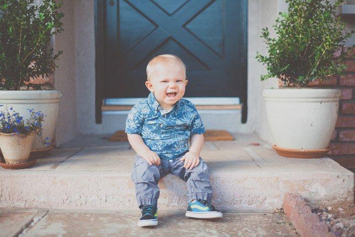 happy child sitting on doorstep
