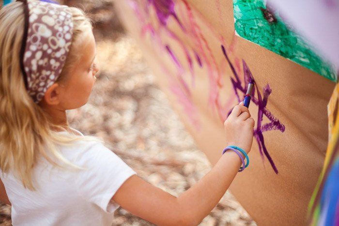 candid child photography of a little girl drawing